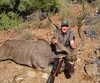 "Martino Ferreira - Professional Hunter with a 57"" EC Kudu"